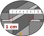 Bei der Montage von KRAIBURG Laufgangbelägen 1 cm Abstand zur Führungsrinne halten